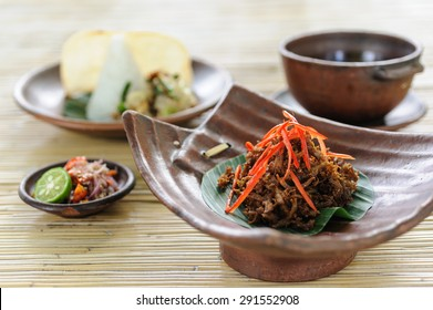 Balinese crispy duck garnished with chillies and served with sambal, soup, rice and vegetable.