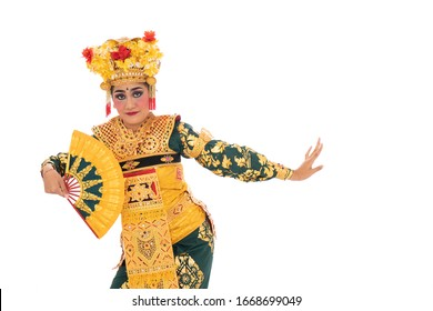 Balinese dancers hold a fan, traditional Indonesia dance culture costume