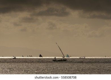Balinese Fishing Boats on the Indian Ocean. Fishing boats, called jukung, return to shore on the east side of Bali after a night of fishing for mackerel and barracuda during a lovely sunrise.