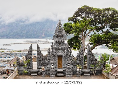 Balinese Hindu Temple by a Fishing Village Amidst Fog and Volcanic Landscape of Mt. Batur in Bali, Indonesia