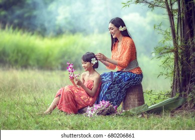 Balinese Lady strengthening beauty to each other.