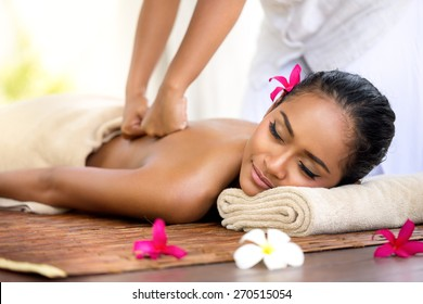 Balinese massage in spa environment,  deep massage of back