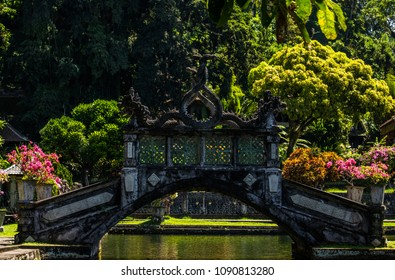 Balinese style carved stone bridge surrounded by green nature