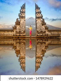 Balinese women in traditional costumesis standing in the gate of Lempuyang temple on Bali isalnd, Indonesia