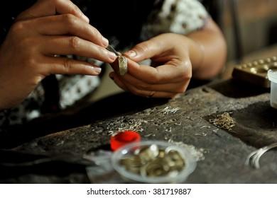 Balinese women working on a silverware at Celuk village, Bali, Inodnesia