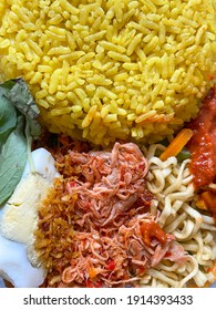 Balinese yellow rice with complete condiment