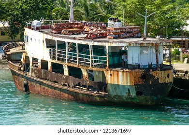 Balingoan, Cagayan de Oro, Mindanao, Philippines - November 16 2006: A floating coffin in Balingoan Harbour, meaning a ship that is obviously not fit for purpose