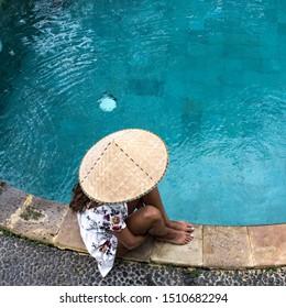 Bali/Ubud/Indonesia/7-9-2017 Bali girl standing by the pool
