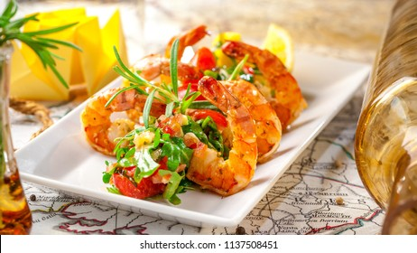 Balkan cuisine. Sea prawns with Mexican salsa on the background of geographical maps, rope and empty bottles. concept sea voyage. Copy space, selective focus