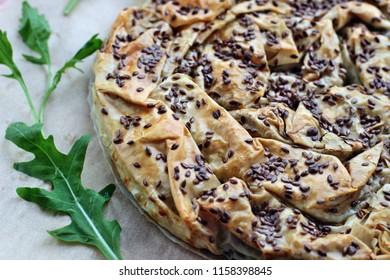 Balkan meat pie, arugula, flax seed. A wonderful breakfast is a good mood all day long. Balkan Bakery Breakfast.