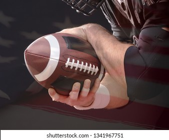 Ball of American Football in footballer hands on US flag background