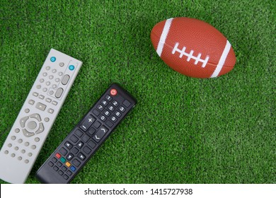 Ball for baseball and remotes from the TV on the green grass, Watch the match, live broadcast, championship. Fan. American football
