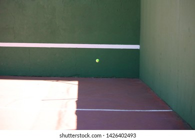 ball bouncing on a racquetball court