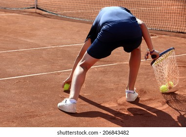 A ball boy in action