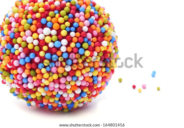 a ball coated with nonpareils of different colors on a white background