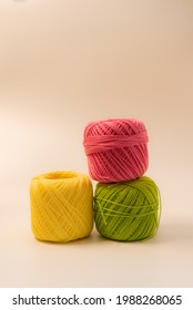 Ball of colored cotton, on white background