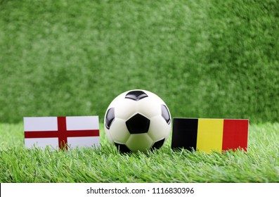 ball with England VS Belgium flag match on Green grass football 2018
