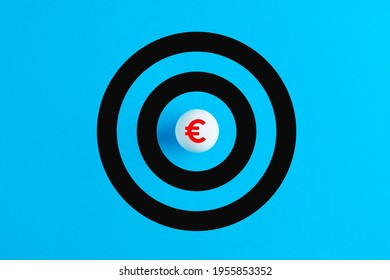 Ball with euro symbol as the bulls eye of a target. Financial goals or currency investment concept.