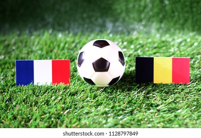 ball with France VS Belgium flag match on Green grass football 2018