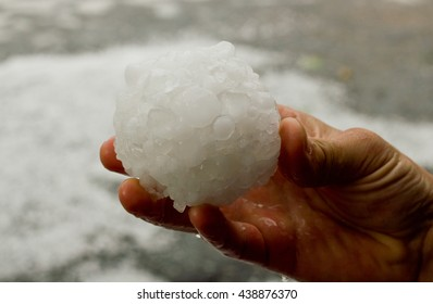 Ball of hail in the hand of man