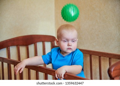 The ball hit a small child who is standing in the crib