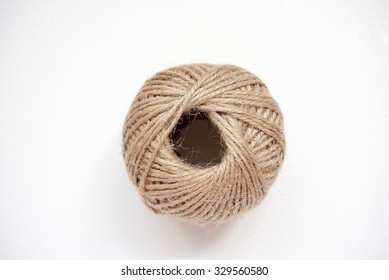 a ball made of brown cotton string