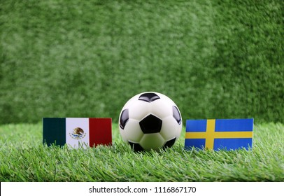 ball with Mexico VS Sweden flag match on Green grass football 2018