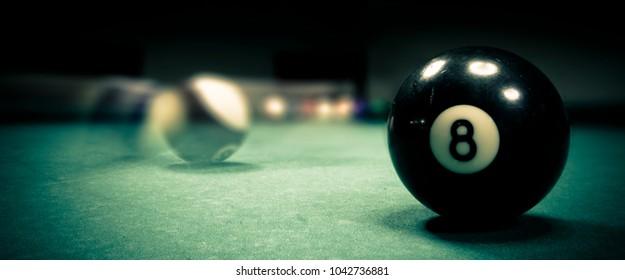 ball n. 8 on a pool table
