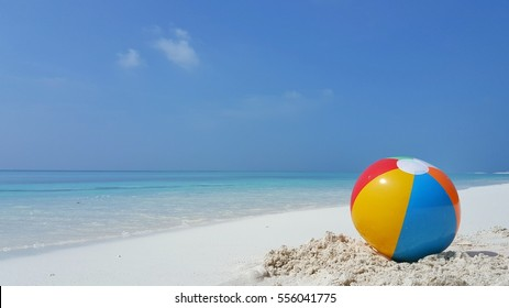 ball on the beach with blue sea and sly background