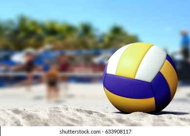 Ball on the beach with people playing volleyball in background