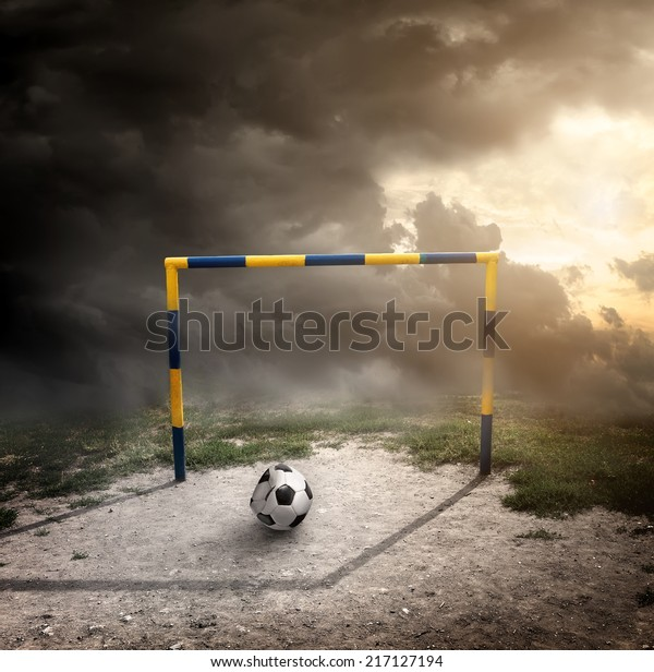 Ball on the football field under cloudy sky