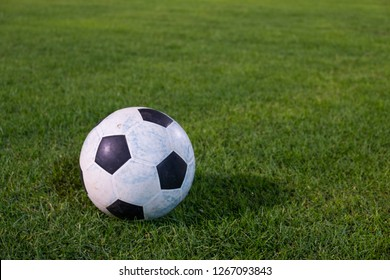 a ball on green grass field night time