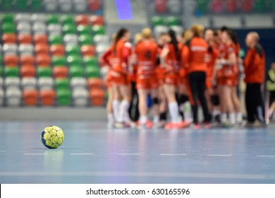 Ball on the parquet during the time in handball match.