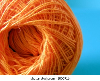 Ball of orange yarn.