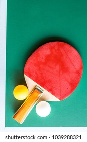 ball and paddle on green table