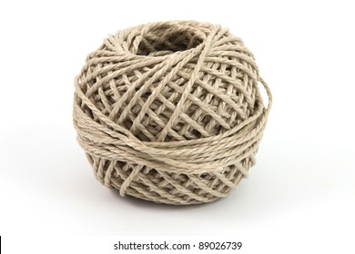 Ball of parcel string with a white background