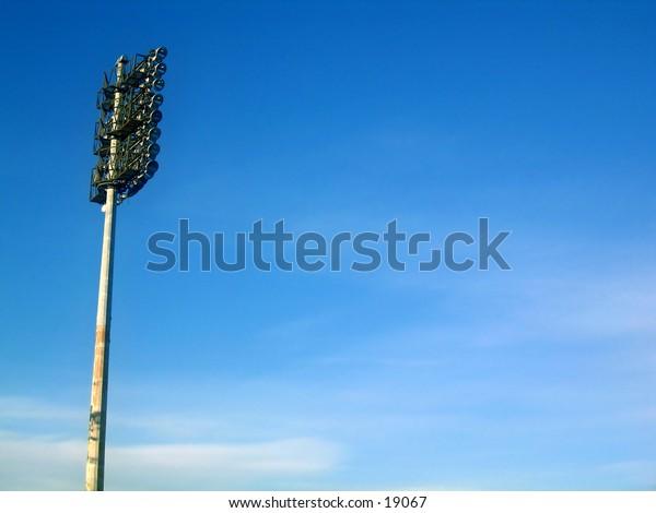 ball park lighting in blue sky