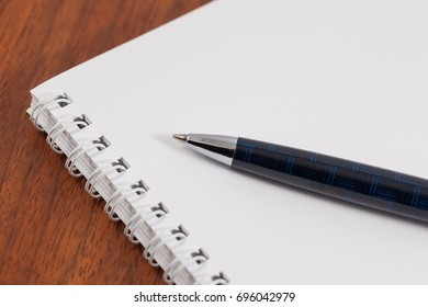 Ball pen and notebook For notes, business.