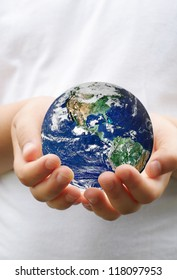 ball planet in the hands of children.Elements of this image furnished by NASA