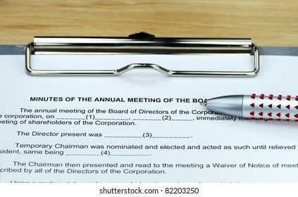 A ball point pen placed on a form for taking the Board minutes, in preparation for the meeting.