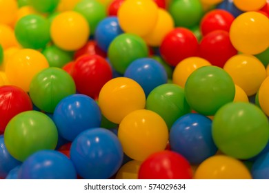 Ball pool, lots of colorful plastic balls in playground