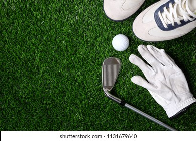 ball, shoe, glove, tee and golf-club driver, golf gear and equipment on flat lay top view.