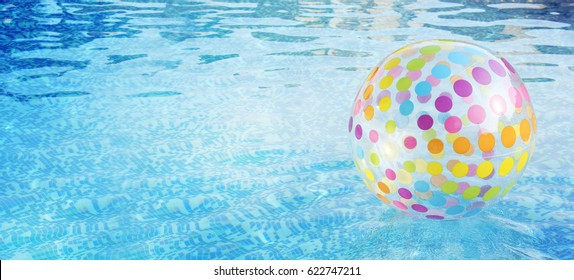 Ball in the swimming pool. Summer vacation.