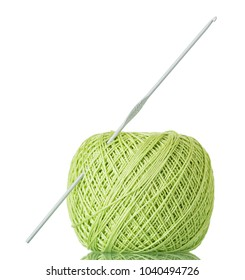 Ball of thread and crochet hook for manual knitting isolated on white