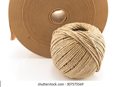 Ball of twine and paper adhesive tape.