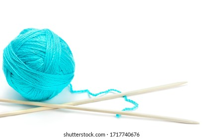 Ball of woolen thread and knitting needles isolated on white background. The concept is hobbies and handicrafts. Free space for text.