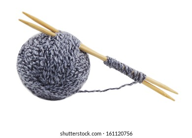 ball of yarn, bamboo needles are isolated on a white background