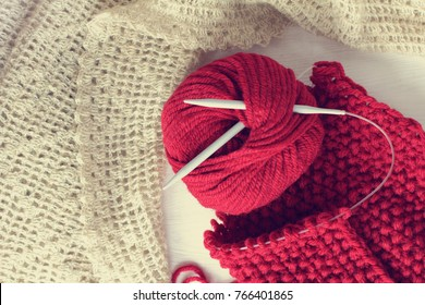 ball of yarn and knitting needles on background scarf and shawl handmade