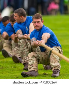 BALLATER, ABERDEENSHIRE, SCOTLAND - 11 AUGUST: This is a Tug O War Team in action at Ballater Highland Games, Aberdeenshire, Scotland on 11 August 2016.
