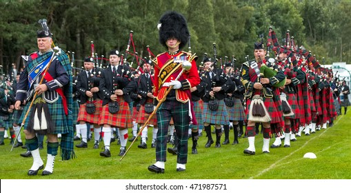 BALLATER, ABERDEENSHIRE, SCOTLAND - 11 AUGUST: This is Massed pipe bands march past at Ballater Highland Games, Aberdeenshire, Scotland on 11 August 2016.